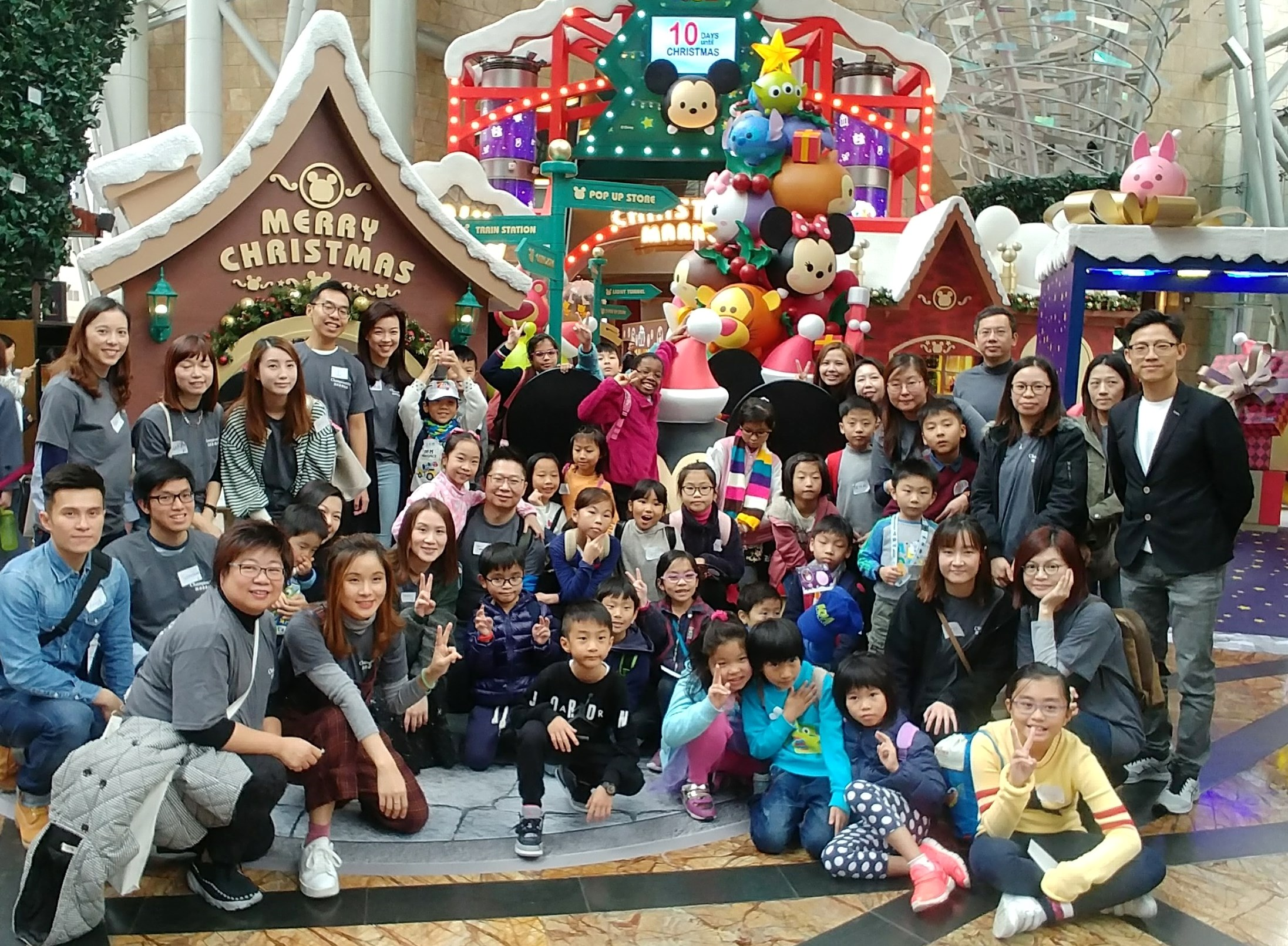Bringing children from Tai O to join Disney TSUM TSUM Christmas Market in Langham Place Mall